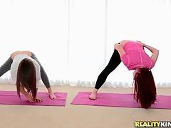 Two hot looking babes Malena and Melody do stretching exercises together.