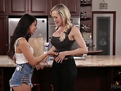 Gina starts licking her ass cheeks as she removes her panties and starts eating her from behind. It`s Brandi`s turn now as Gina as climbs on the counter telling her she`s been a dirty girl and that it`s time clean her pussy with her tongue. Tongue fucking